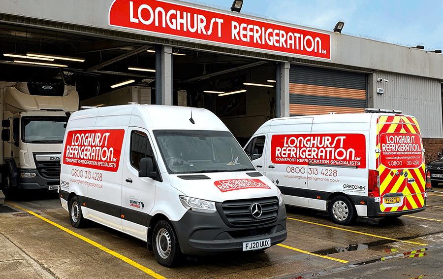 Two Longhurst Refrigeration vans outside a depot